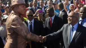 South Africa's leader Jacob Zuma shaking hands with a mime artist in Cape Town, South Africa - Thursday 25 April 2013