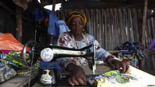A woman using a sewing machine in Gatumba, Burundi - Friday 19 April 2013