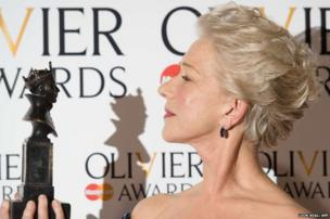 British actress Helen Mirren poses with her award for best actress during the Lawrence Olivier Awards for theatre at the Royal Opera House in London