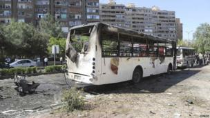 A damaged bus is pictured at the site of an explosion in the Mazzeh neighbourhood of Damascus, 29 April 2013