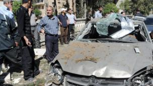 People gathered at the scene of a blast in the Mazzeh district of Damascus, handout picture released by the Syrian Arab News Agency (SANA), 29 April 2013