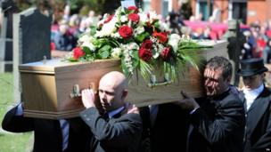 Anne Williams' coffin is carried