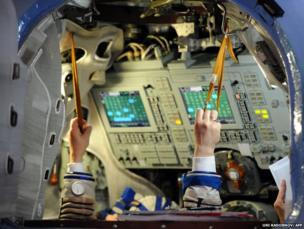 The hands of Russian cosmonaut Fyodor Yurchikhin