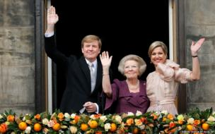 Dutch King Willem-Alexander and his wife Maxima (right) and Princess Beatrix