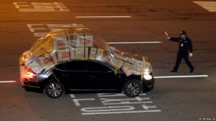 A South Korean vehicle fully loaded with goods and products brought back from North Korea's Kaesong industrial complex