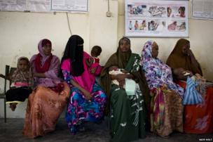 Mothers wait with their babies to be vaccinated at Medina Mother and Child Health Centre in Mogadishu, Somalia