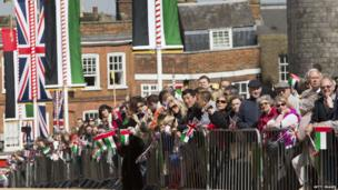 Crowds on the streets of Windsor to catch a glimpse of the Queen and the rest of the procession on the way to Windsor Castle