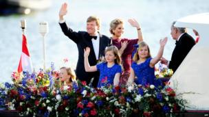 King Willem-Alexander (L) and Queen Maxima (R) with Crown Princess Amalia (front R), Princess Alexia (M) and Princess Ariane (L) wave to spectators and performers