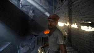 Worker in Mumbai, India, 1 May