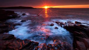 Dawn breaks on the coast of the Acadia National Park in Maine in the US, 2 May 2013