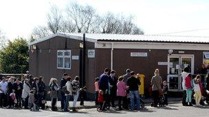 People queue in Swansea for the MMR jab