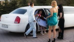 Gay couple in their wedding limousine in Kazakhstan