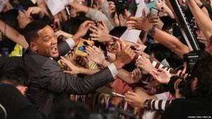 Actor Will Smith gives his autograph