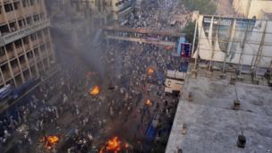 Protesters start fires in the streets of Dhaka, Bangladesh, on 5 May 2013