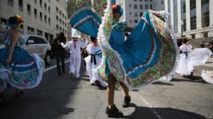 A girl dances at a Cinco de Mayo march in Denver, Colorado
