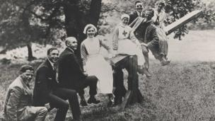 Nurses and members on a seesaw in Regent's Park in 1915