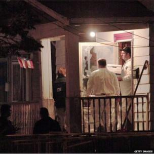 FBI agents at the house in Cleveland where Amanda Berry, Gina DeJesus and Michelle Knight were found, 7 May 2013