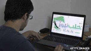 Syrian man uses laptop computer