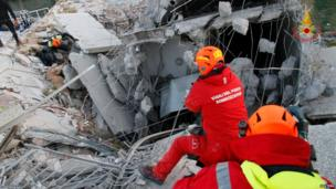 Rescue workers in the rubble of the collapsed control tower in the port of Genoa (8 May 2013)