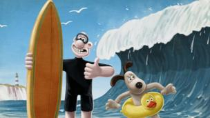 Wallace and Gromit ready to surf.
