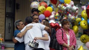 Friends and family of kidnapping victim Gina DeJesus gather outside her family home awaiting her return, 8 May 2013