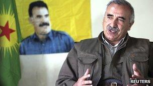 Murat Karayilan, acting military commander of the Kurdistan Workers Party (PKK), speaks during an interview in Iraq's Qandil mountains