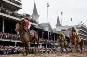 Orb, ridden by jockey Joel Rosario, wins the Kentucky Derby horse race