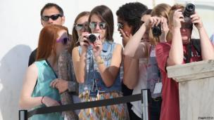 Young Prince Harry fans with cameras