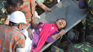 Rescuers pull a woman called Reshma from the rubble at the Rana Plaza (10 May)