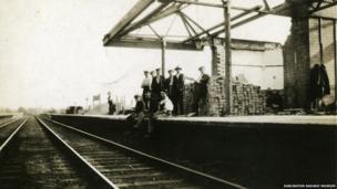Men sitting on a platform