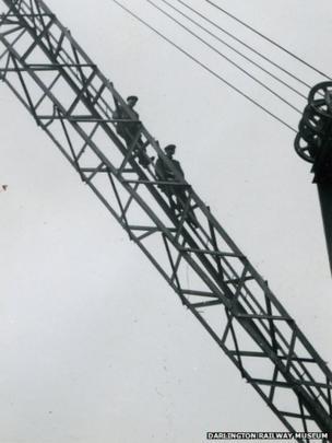 Men sitting on a bridge