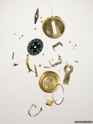 Disassembled compass
