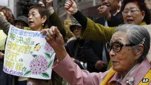 Former South Korean comfort woman, Kim Bok-dong, 87, front, takes part in an anti-Japan protest against the Japanese lawmakers' visit to the Yasukuni Shrine in Seoul, South Korea, 24 April 2013