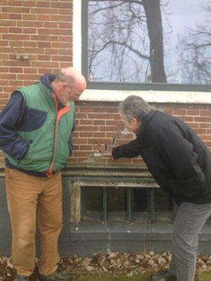 Klaas Koster and Jannette Schoorl point to a crack in the wall of their home in Middelstum, the Netherlands