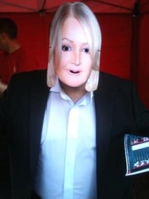 A member of the public wearing a Bonnie Tyler mask