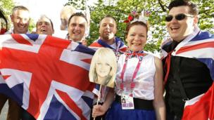 British fans hold national flags and a placard of Bonnie Tyler in Malmo, Sweden