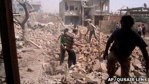 Photo supplied by Qusair Lens shows result of air strike in Qusair. 19 May 2013
