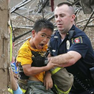 A boy is pulled from the wreckage of Plaza Towers Elementary School in Moore