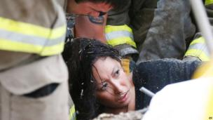 A woman is pulled out from under tornado debris at the Plaza Towers School
