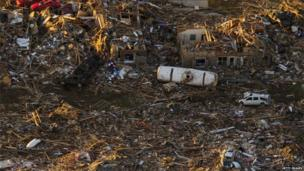 An aerial view of destroyed houses and buildings after a powerful tornado ripped through the area on 21 May 2013 in Moore, Oklahoma.