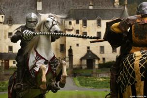 A team of medieval jousters practice