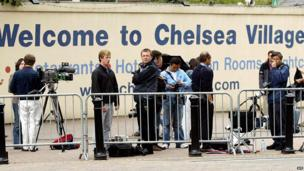The media wait in front of Chelsea Football Club in London on 2 July, 2003.