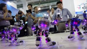 Robots dancing at China International High-Tech Expo in Beijing, May 23
