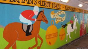 Rosemary Cunningham mural showing horses racing