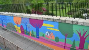 Paul Leith mural on underpass showing park and trees