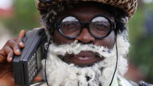 A clown at the funeral of author Chinua Achebe, in Ogidi, Nigeria (23 May 2013)
