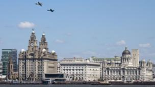 Two spitfire airplanes flying over the Liverpool Three Graces to mark the 70th anniversary of The Battle of the Atlantic. Photo: Mathieu Bangert