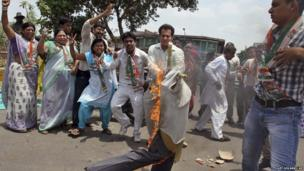 Supporters of India's ruling Congress Party burn an effigy representing a Maoist rebel.