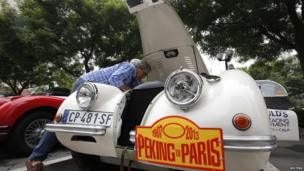 Albert Bessudo checks his Jaguar XK120 ahead of the Peking to Paris Motor Challenge in Beijing.