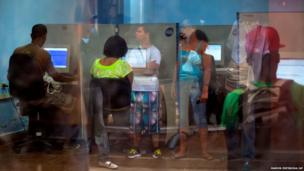 People line up at a post office in Havana